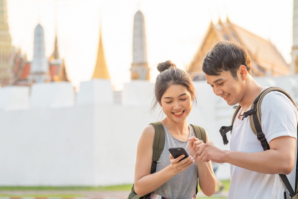 Traveler Asian couple direction on location map in Bangkok, Thai