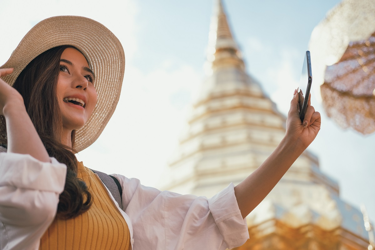woman use smart phone to take photo. traveler tourist travel on