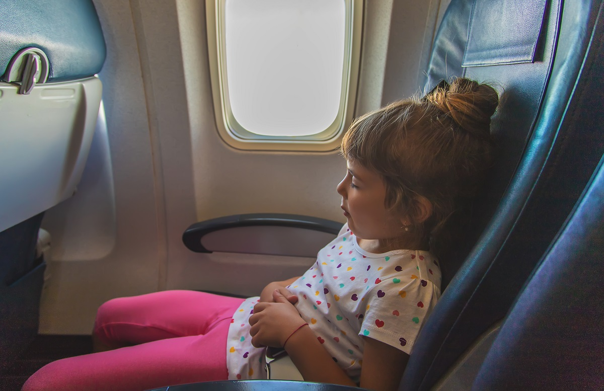 The child is sleeping on the plane. Selective focus.