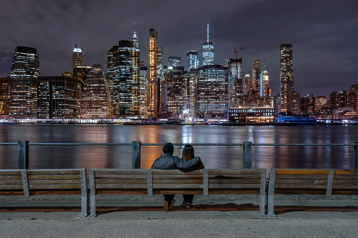 Scene of back side couple sitting and looking New york Cityscape